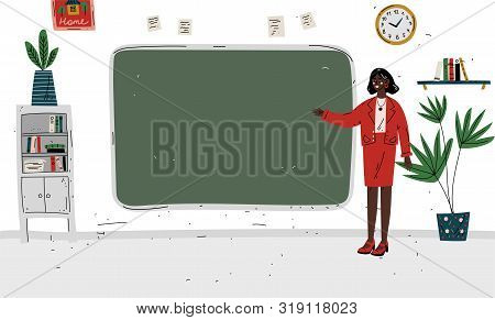 Lesson. Teacher Standing Near Blackboard In Classroom.