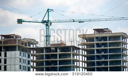 Tower Crane And Building Activity. Construction Site Background. Industrial Background.