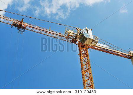 Construction Crane Near The Building Under Constructionю Construction Site. Industrial Background.
