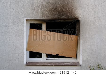 Barricaded Window After The Fire Damage In An Apartment House, Concept For Arson, Negligence And Ins