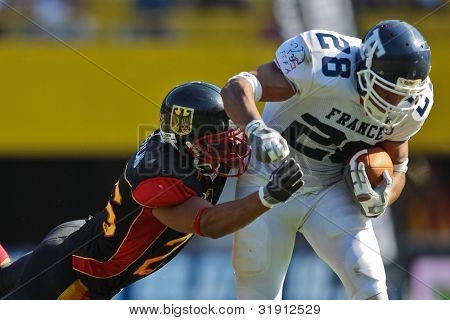 VIENNA, AUSTRIA - JULY 16 RB Laurent Marceline   (#28 France) is tackled at the Football World Championship on July 16, 2011 in Vienna, Austria.