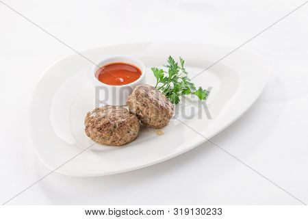 Meat Patties With Tomato Sauce Isolated On White Background Side View