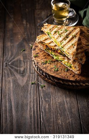 Food Background With Healthy Toasts With Avocado, Cheddar Cheese And Tomatoes For Breakfast Or Lunch