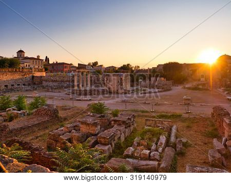 Athens, Greece - July 19, 2019 Columns And Walls Of Ruined Hadrians Library In Center Of Athens Agai