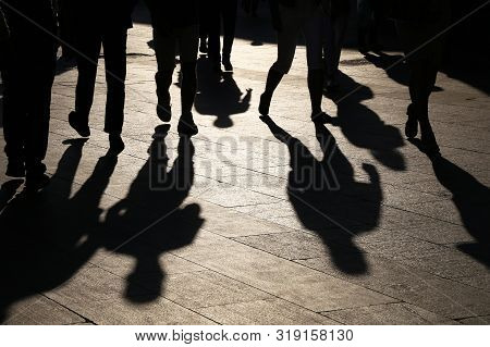 Black Silhouettes And Shadows Of People On The Street. Crowd Walking Down On Sidewalk, Concept Of Pe