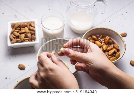 Preparation of almond milk from soaked and peeled nuts. Vegan Milk Alternative concept poster