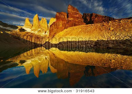 Towers with reflection at sunrise, Torres del Paine National Park, Patagonia, Chile