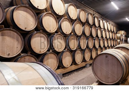 France Beaune 2019-06-20 Wooden Wine Oak Barrels Stack In Rows In Order, Old Cellar, Winery, Vaults.