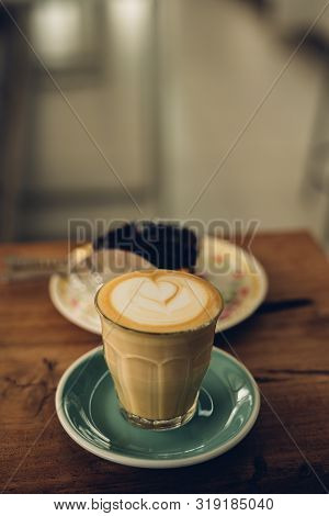 Cup Of Coffee Latte In Coffee Shop.beautiful Foam,ceramic Cups, Place For Text.