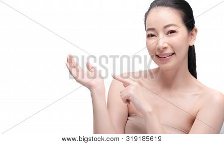Portrait Of Young Beautiful Asian Woman With Clean Fresh And Without Makeup Skin. Healthy Skin Girl