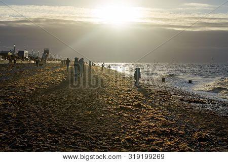 Hunstanton, Norfolk, England, Uk - January 1, 2019: Foggy Winter Day In Hunstanton Beach, People Lok