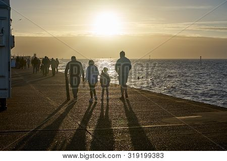 Hunstanton, Norfolk, England, Uk - January 1, 2019: People Walking In Foggy Winter Day In Hunstanton