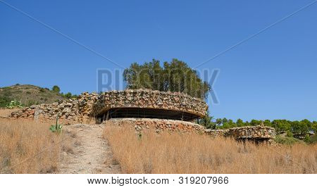 Loophole Embrasure Old Military Bunker, Artillery Fire Control Center On Blue Sky Background. An Aba