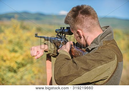 Man Aiming Target Nature Background. Aiming Skills. Hunter Hold Rifle Aiming. On My Target. Bearded