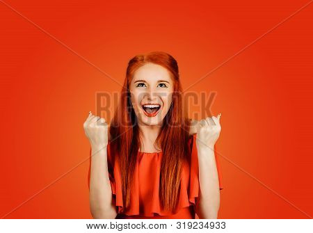 Happy successful student, euphoric woman winning, fist pumped, celebrating success isolated on Red background poster