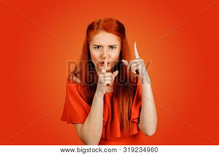 Shh. Angry Woman Showing Shh, Silence, Hush Sign Gesture With One Hand And Attention Listen To Me Wi