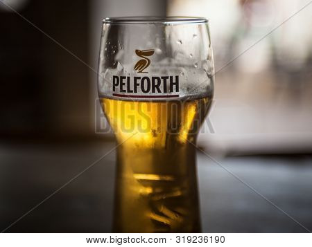 Lyon, France - July 16, 2019: Pelforth Logo On One Of Their Sponsored Glasses Containing Light Beer.