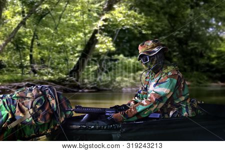 Special Force Soldier On Raft During The Military Operation In Water