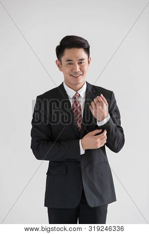 Close Up Shot Of Handsome Asian Businessman In Black Suit Standing With Self Confident. Concept For
