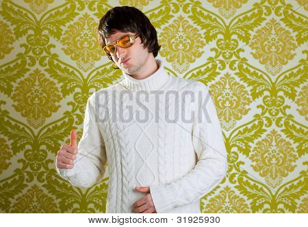 retro hip young man with vintage glasses and winter  turtleneck sweater on wallpaper