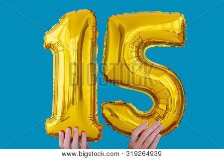 Gold Foil Number 15 Fifteen Celebration Balloon On A Blue Background