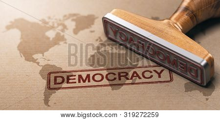Rubber Stamp Over Paper Background With A World Map Watermark Printed And The Word Democracy. Concep