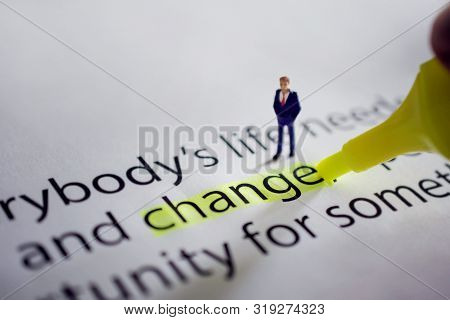 Change For New Challenge In Life Or Business Concept. Miniature Fugure Of Businessman With Marker Pe