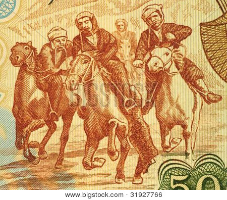 AFGHANISTAN - CIRCA 1979: Horsemen Competing at Buzkashi on 500 Afgani 1979 Banknote from Afghanistan.