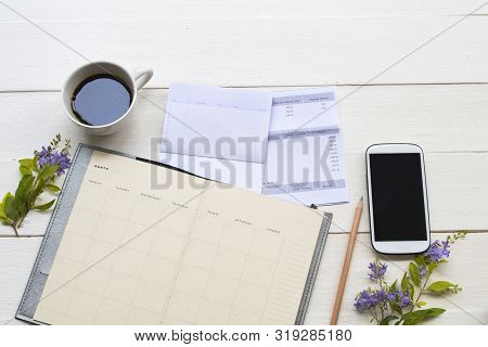 Saving Account Passbook Bank ,statement Due Expenses Of Credit Card ,notebook Planner And Mobile Pho