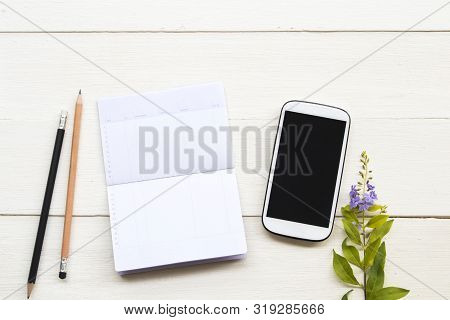 Saving Account Passbook Bank And Mobile Phone For Business Work With Flowers Arrangement Flat Lay St