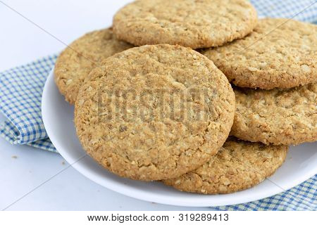 Homemade Shortbread Cookies Made Of Oatmeal Are Pile On White Plate On The Cloth Background. Concept