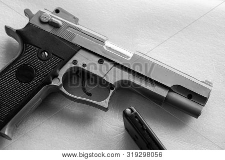 Bb Gun, Old Airsoft Pistol Toy And Magazine With Bb Gun Bullets On White Background. Black And White
