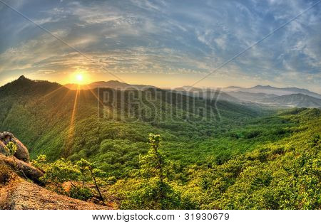 Fish-eye view of majestic sunset of the Russian Primorye mountains landscape HDR image