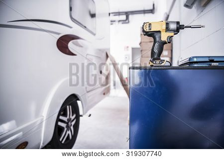 Camper Van Rv Repair Concept. Recreational Vehicle In The Service Center. Drill Driver Power Tool.
