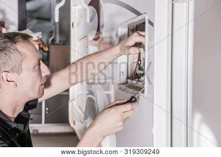 Caucasian Rv Repair Technician In His 40s Looking For Potential Problem Inside Travel Trailer Propan