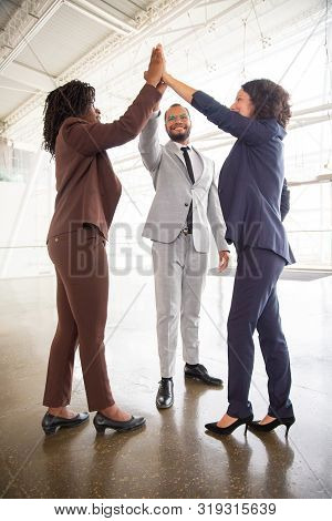 Business Team Giving High Five. Full Length View Of Cheerful Multiethnic Business Colleagues Celebra
