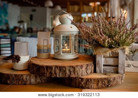 Pink Heather.cozy Home Autumn Mood .wooden Table With Autumn Decor, Lantern, Candles And Flowers.hea