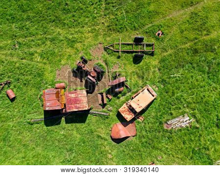 Aerial image of a derelict junk and field in disarray