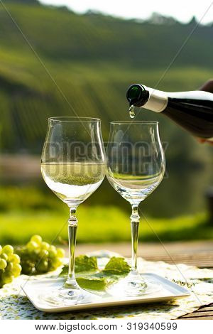 Famous German Quality White Wine Riesling, Produced In Mosel Wine Regio From White Grapes Growing On