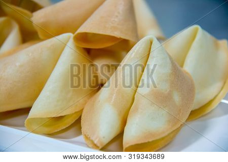 A Surprise Fortune Cookies On White Plate