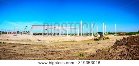 poster of Panorama showing the grader is leveling a landscape, transform into urban area. View on construction site.