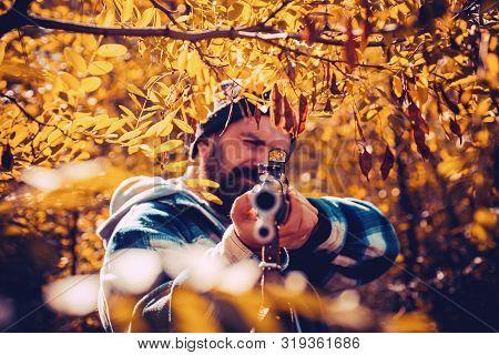 Hunter Man Hunting. Hunting Period, Autumn Season. Male With A Gun. A Hunter With A Hunting Gun And