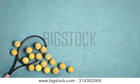 tennis racket and ball on a blue background
