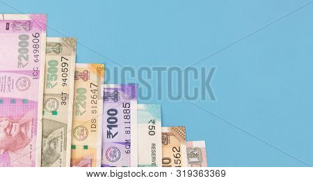 Concept Of Economic Slowdown And Economic Growth Showing With Indian Currency Notes In Decreasing Or