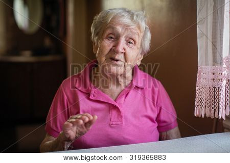 Old lady pensioner in the kitchen portrait.