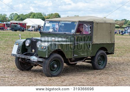Haselbury Plucknett.somerset.united Kingdom.august 18th 2019.a Vintage Land Rover Is Being Driven At