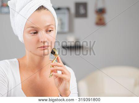 Dermaroller For Mesotherapy. Beautiful Woman Is Using Anti Aging Derma Roller. Woman Is Making Needl