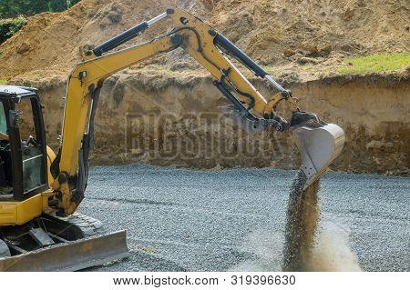 Excavator Bucket Shovel Moving Stones Of Foundation Backfilling Stone Of Foundation