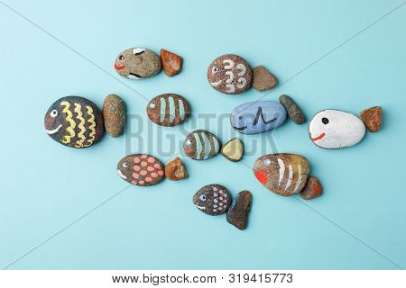 Multicolored Stones And Creative Fish Made Of Stone. The Painting Is Painted In Different Colors In