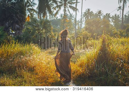 Silhouette Of Beautiful Young Boho Woman Outdoors At Sunset